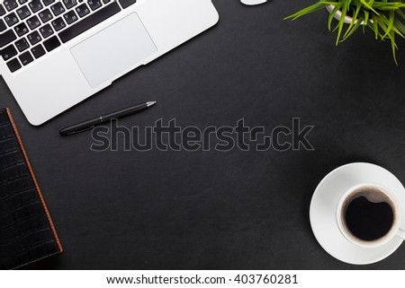 Office leather desk workplace table with laptop, coffee cup, notepad and plant. Top view with copy space - stock photo