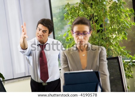 Office life: business team having a fight - stock photo