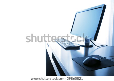 Office life,computer with desk isolated on the white--toned blue. - stock photo