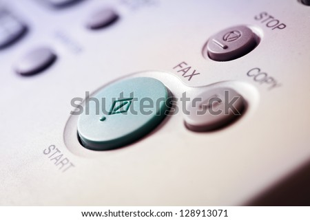 Office life, fax, copy machine, start button close up - stock photo