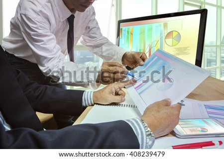 office life theme of business man working on graph report - stock photo