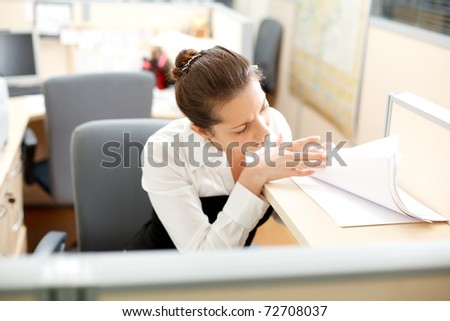 Office life. Woman searches for documents at the table. - stock photo