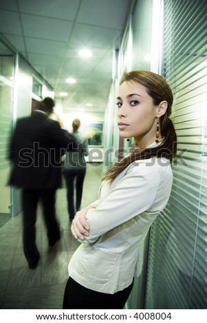 Office life: young business woman in a crowded office