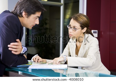 Office life: young salesclerk talking to a customer - stock photo