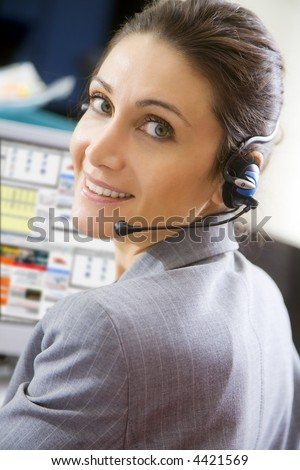 Office life: young switchboard operator representative smiling