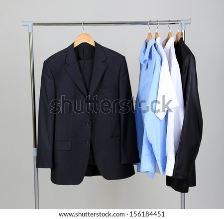 Office Male Clothes On Hangers, On Gray Background