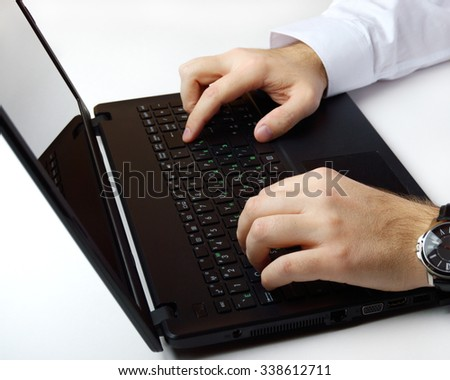 office man typing on computer