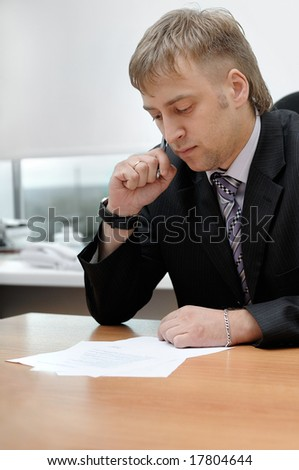office manager reading the document - stock photo