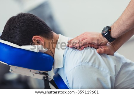 Office massage on chair - stock photo