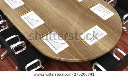 Office meeting room round desk with working papers and pencils - stock photo