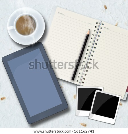 Office objects , notepad, tablet computer, photo frames, coffee cup on background. - stock photo