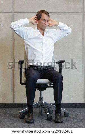 office occupational disease prevention -business man exercising on chair - stock photo