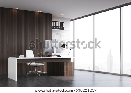 Office of a head of a company with dark wood walls, a panoramic window and a table with computer on it. 3d rendering. Mock up.