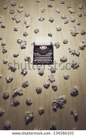 office of a journalist or author with an old typewriter on wooden floor - stock photo