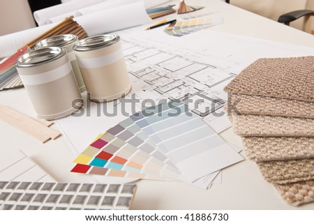 Office of interior designer with paint and color swatch on the desk - stock photo
