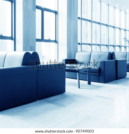 Office of the sofa and corridors, modern building interior. - stock photo