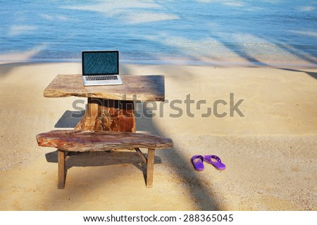 office on the beach - stock photo