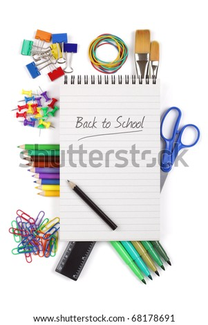 Office or student stationary supplies with spiral notebook and back to school message - stock photo