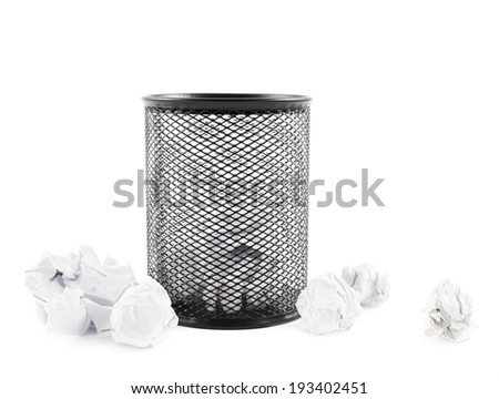 Office paper black trash bin next to crumpled paper isolated over the white background