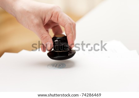 Office paper document stamp in business human hand