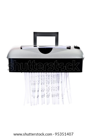Office paper shredder at work - isolated on white background - stock photo