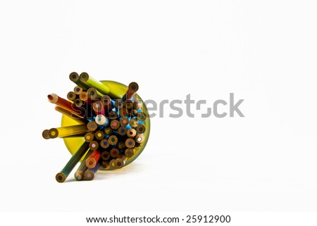 Office Pens and crayons in many colors  in a cup - stock photo