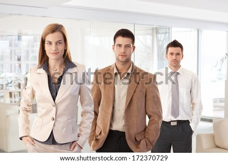 Office portrait of successful young business team.