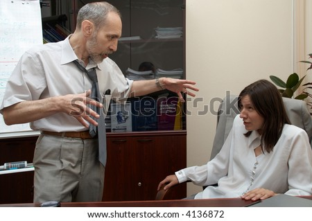 Office problem. Boss puts pressure on Secretary. - stock photo