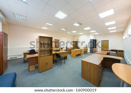 Office room with empty furniture and sofa