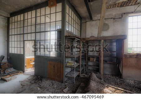 office room with glass of abandoned factory