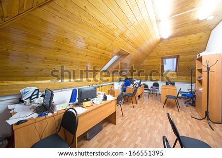 Office room with wooden ceiling in the attic - stock photo