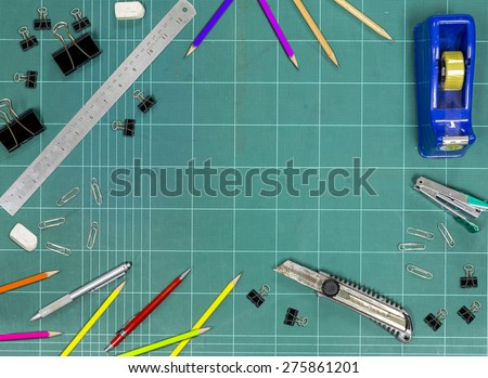 Office  , school accessories on the cutting mat - stock photo