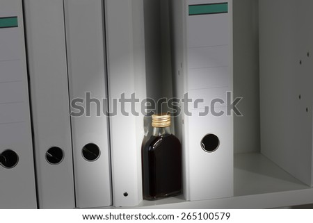 Office, shelf with white folders and pocket flask - stock photo