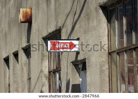 Office Sign with Arrow on Old Building - stock photo