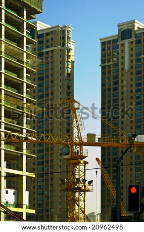 office skyscraper building on construction with big crane