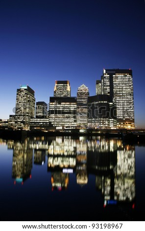 Office skyscrapers in Canary Wharf at Night. Canary Wharf is the main financial district at London - stock photo