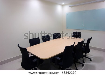 Office space. Meeting room. Image in frame is isolated for easier replacing. - stock photo