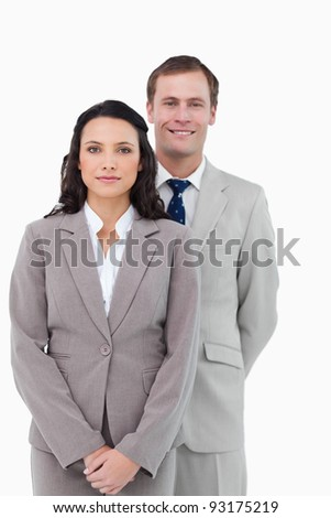 Office staff standing together against a white background