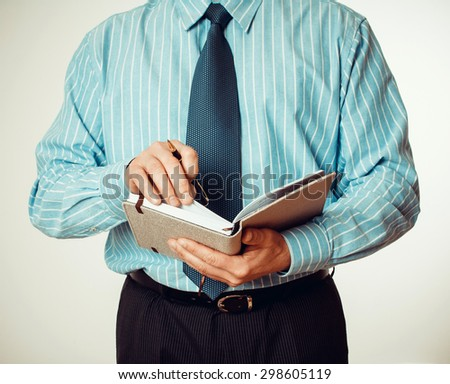 Office staff writes notes in the diary, close up - stock photo