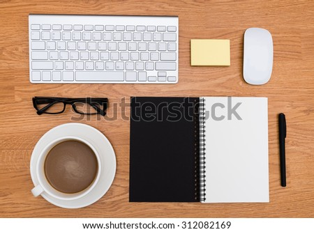 Office stationery accessories  desk from  top view with brown wood background / Mix of office supplies and gadgets on a wooden desk background.  - stock photo