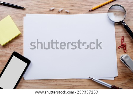 Office stationery and mobile phone on the table with copy space for texts - stock photo