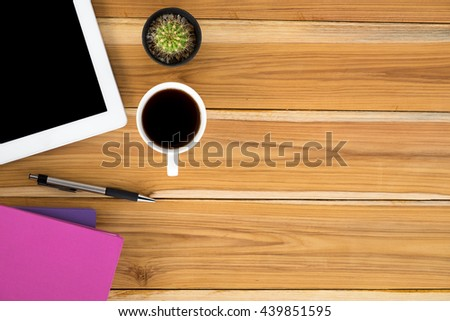 Office stuff with blank screen tablet,pen,leather notebook and cup of coffee. Top view office gadgets with copy space. - stock photo