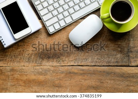office stuff with keyboard smartphone notepad and coffee cup mouse top view shot.  - stock photo