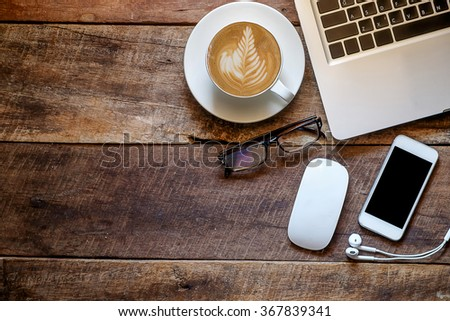 office stuff with laptop smartphone and coffee cup mouse top view shot. - stock photo