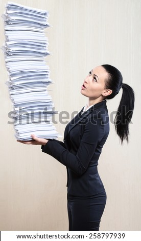 Office superwoman - stock photo