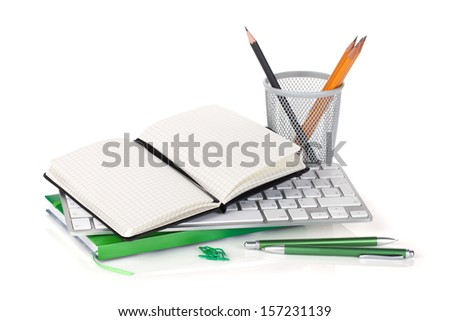 Office supplies and computer keyboard. Isolated on white background - stock photo
