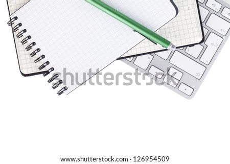 Office supplies and computer keyboard. View from above. Isolated on white background - stock photo