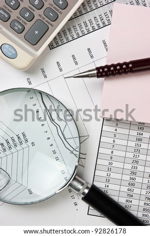 office supplies and working papers on the table - stock photo