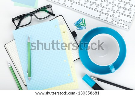 Office supplies, computer keyboard and coffee cup. View from above. On white background - stock photo
