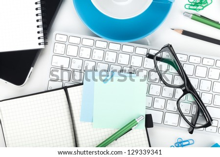 Office supplies, glasses and computer keyboard closeup - stock photo
